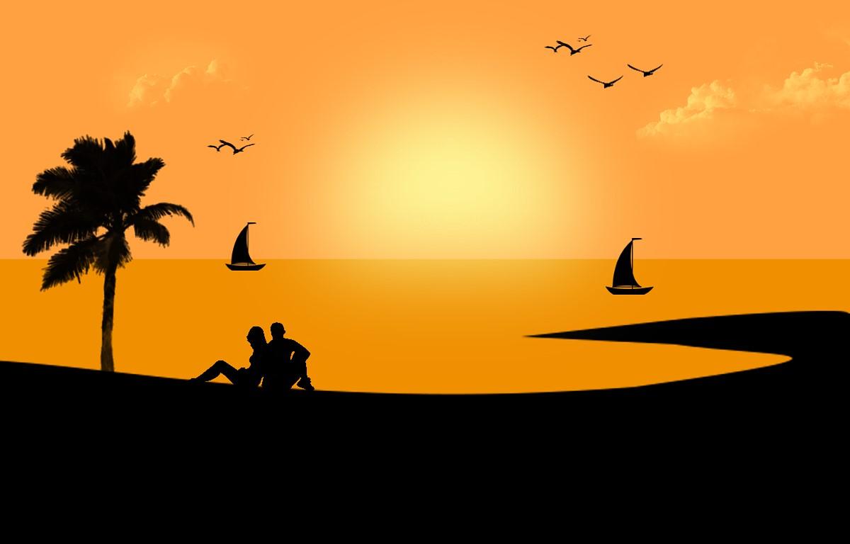 Silueta de una playa con el sol al fondo